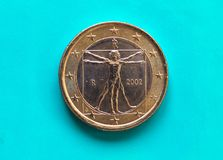 1 euro moneta, Unione Europea, Italia sopra verde blu Fotografie Stock Libere da Diritti