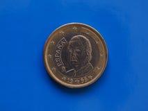 1 euro moneta, Unione Europea, Spagna sopra il blu Fotografia Stock Libera da Diritti