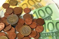 Euro monete e banconote Immagini Stock Libere da Diritti