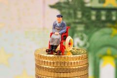 Euro monete, figura, banconota Fotografia Stock