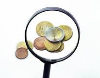 Euro monety Przez A Powiększać - szkło Fotografia Stock