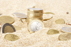 Euro monety w piasku Fotografia Stock