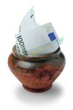 Euro money. Euro paper money in clay pot, on white background Royalty Free Stock Photography