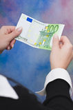 Euro money. Woman's hand holding five green 100 euro banknotes Stock Photos