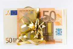 Euro money. European 50 euro paper bills, and golden gift ribbon Stock Image