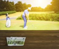 Euro money against the backdrop of a TV on which golf is shown, sports betting, golf euro stock photos