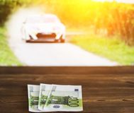 Euro money against the background of the TV on which the car rally is shown, sports betting, euro. Euro money against the background of the TV on which the car stock image