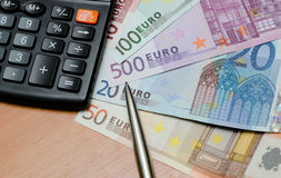 Euro money background and calculator. Close up Stock Photos