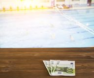 Euro money on the background of the TV by someone shows water polo, sports betting, euro. Euro money on the background of the TV by someone shows water polo royalty free stock photo