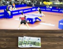 Euro money on the background of a TV on which table tennis is shown, sports betting, ping-pong, euro. Euro money on the background of a TV on which table tennis stock image
