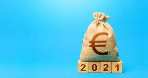 Euro money bag and blocks 2021. Budget planning for next year. Beginning of new decade. Revenues expenses, investment