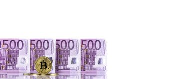Euro money 500 bank notes and bitcoin golden symbol background stock image