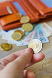 Euro money - banknotes and coins - in brown wallet Royalty Free Stock Image