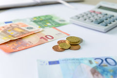 Euro money banknotes and coins counting with calculator Royalty Free Stock Photos