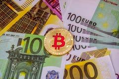 Euro Money Banknotes and golden bitcoin. stock photo