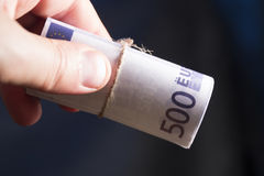 Euro money banknotes. Male hand holding euro money banknotes Royalty Free Stock Photo