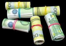 Euro money banknotes roll on a black. Background royalty free stock photography