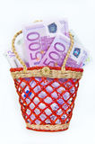 Euro money banknotes in a small basket, isolated. 500 euro money banknotes in a small basket, isolated Royalty Free Stock Images