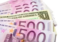 500 euro money banknotes versus 1 dollar isolated on a white royalty free stock image