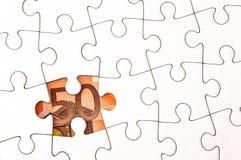 Euro money bill under jigsaw puzzle. 50 Euro money bill under a jigsaw puzzle with missing pieces Stock Images
