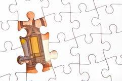 Euro money bill under jigsaw puzzle. 50 Euro money bill under a jigsaw puzzle with missing pieces Royalty Free Stock Photo