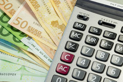 Euro money bills and calculator Royalty Free Stock Photos