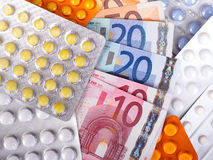 Euro money bills and  pills. Euro money bills and colorful pills Royalty Free Stock Photos