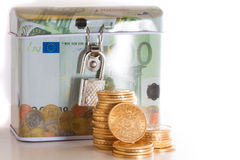 Euro money box and gold coins Stock Images