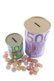 Euro money boxes and coins Royalty Free Stock Image