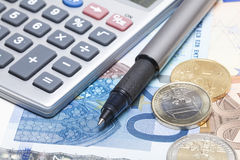 Euro money and calculator Royalty Free Stock Photos