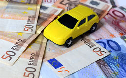 Euro money with car. Euro bills with car at the bacground Royalty Free Stock Images
