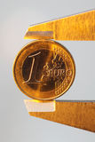 Euro money coin sized by vernier tool Stock Photography
