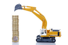 Euro money coins with digger Stock Images
