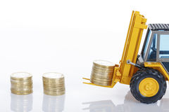 Euro money coins and forklift Royalty Free Stock Photos