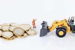 Euro money coins with loader Stock Photography