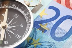Euro money and compass Royalty Free Stock Images