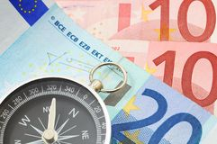 Euro money and compass Royalty Free Stock Photo