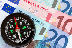 Euro money and compass Stock Photos