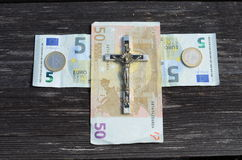 Euro money cross and metal crucifixion concept Royalty Free Stock Photography