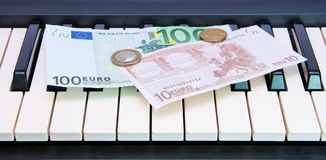 Euro money on electric organ keyboard Stock Image