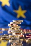 Euro money.Euro Flag.Euro currency.Coins stacked on each other i. N different positions. European union flag Stock Images