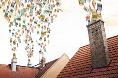 Euro money flies up the chimneys Stock Photography