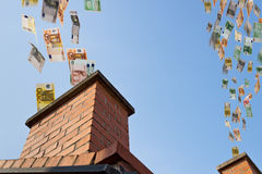 Euro money flies up the chimneys Royalty Free Stock Photo