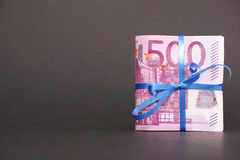 Euro money gift. 500 euro banknote with a nice ribbon for your financial, bonus, cashback, gifts and presents copy - note, that the money is real and used royalty free stock photography
