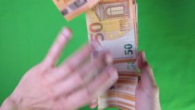 50 Euro money. Hand is counting 50 Euro money on the table stock video