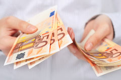 Euro money in hands. Euro money in female hands Royalty Free Stock Photo