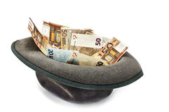 Euro money in a hat. Money in the hat: a loan or deposit Stock Photos