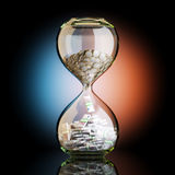 Euro Money In Hourglass On Artistic Background Stock Photography