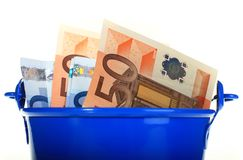 Euro money inside the bucket. Royalty Free Stock Photos