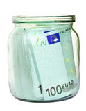 Euro money in a jar. Euro money in a glass jar isolated on white Royalty Free Stock Photos